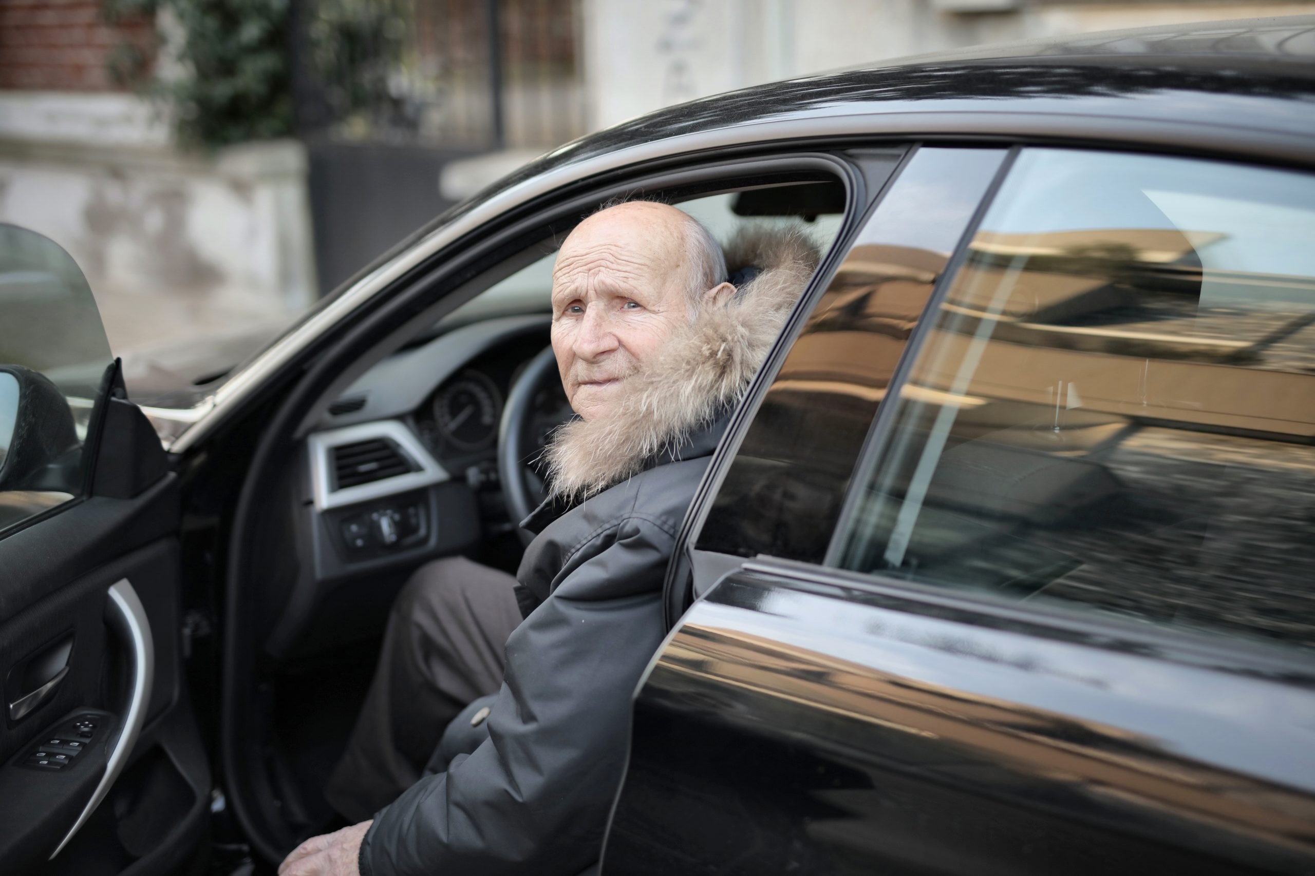 Old man preparing for driving evaluation for seniors