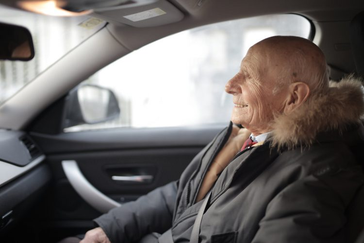 Old man taking driving evaluation for seniors