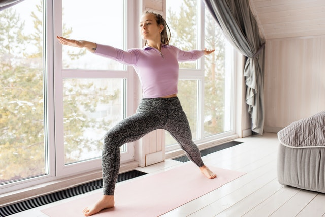 Woman taking online classes for yoga